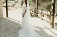 01 The bride was wearing a stunning off the shoulder polka dot wedding dress and a matching veil
