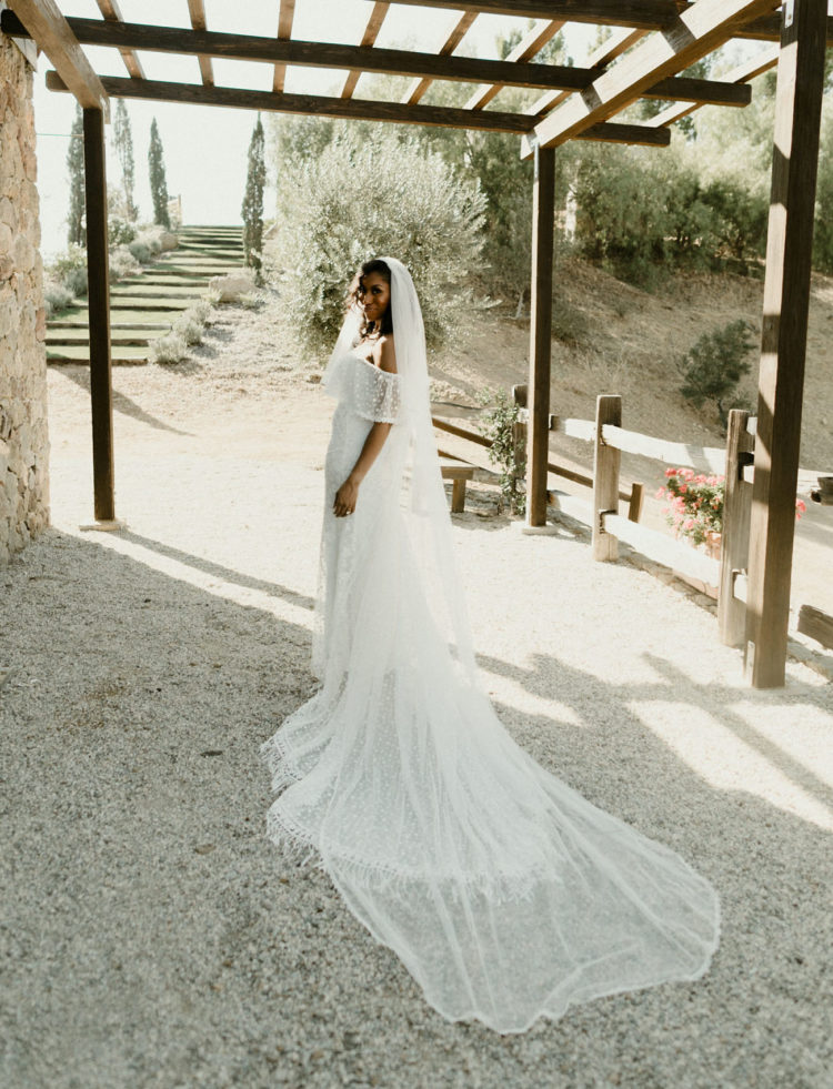 The bride was wearing a stunning off the shoulder polka dot wedding dress and a matching veil