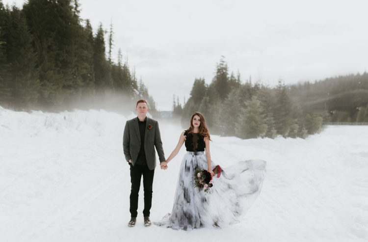 This gorgeous wedding shoot took place in the snowy mountains, and the contrast between dark colors and snow is striking