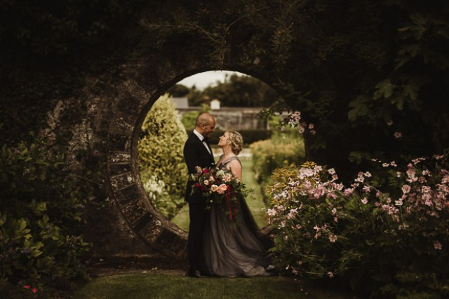 This refined wedding took place in Ireland, and it was filled with dark romance and lush florals