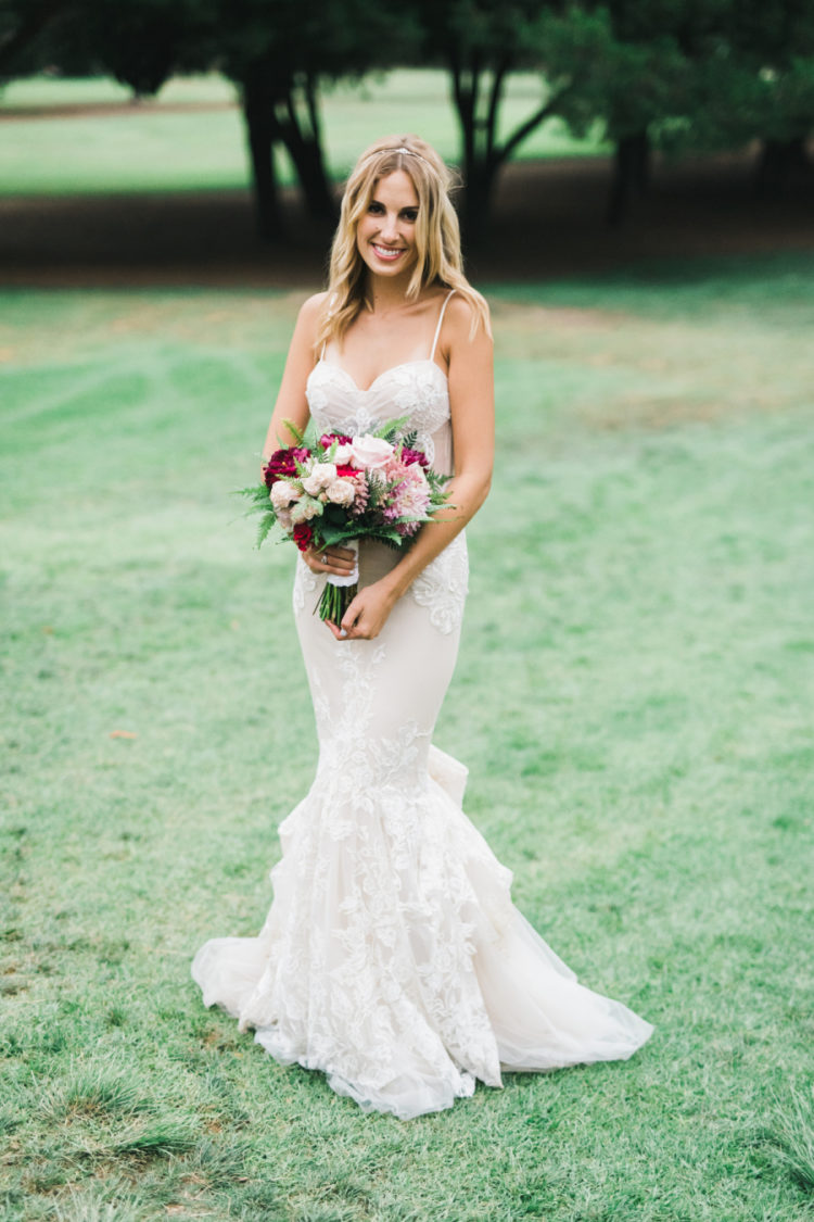 The bride chose a spaghetti strap wedding dress with lace appliques and a sweetheart neckline