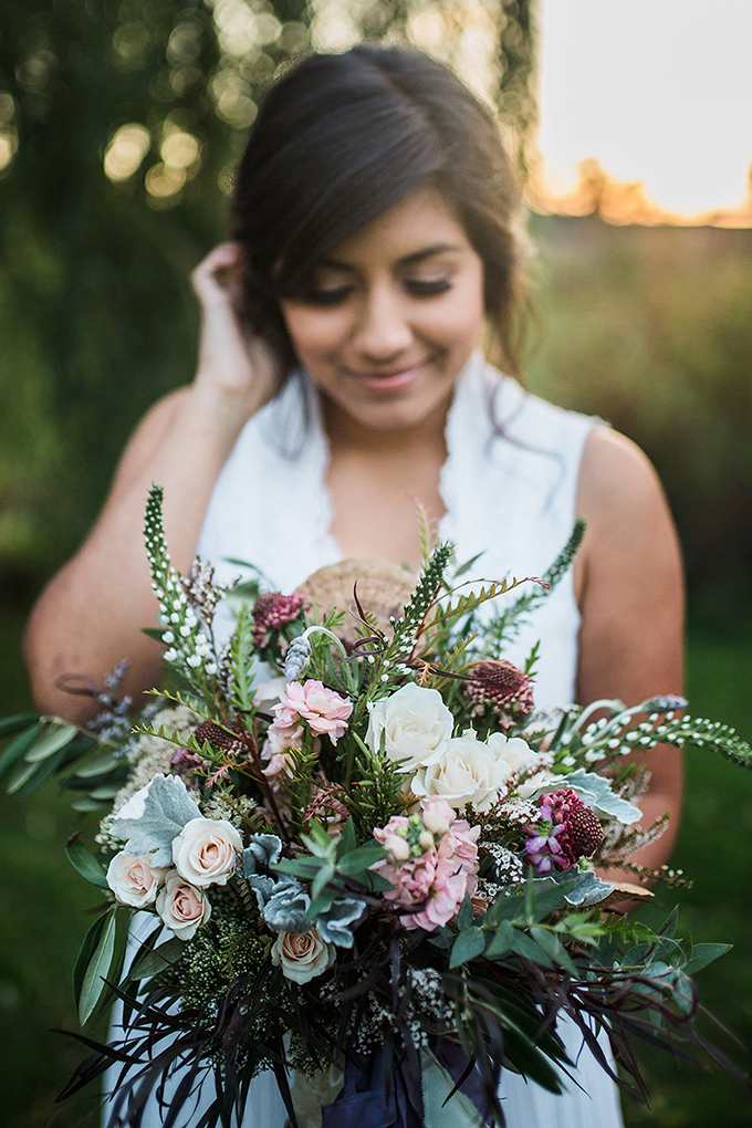 The bride was carrying a gorgeous and super lush wedding bouquet and lots of greenery