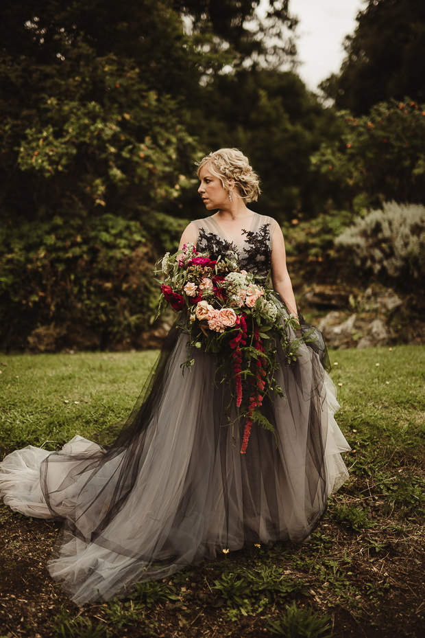 The bride was wearing a unique dress with an overlay, black lace on the bodice