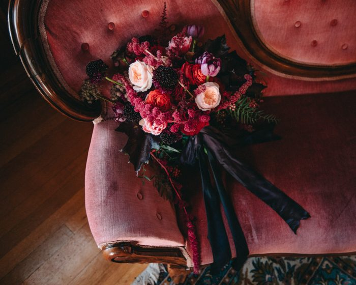 The wedding color scheme was rich and bold, with dark jewel tones