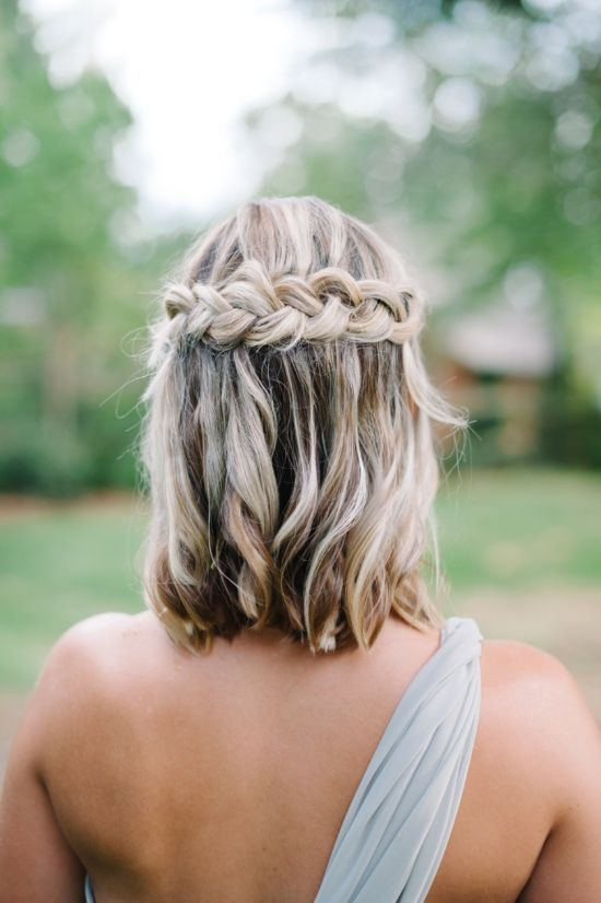 a braided wavy half updo on medium-length hair is a chic idea