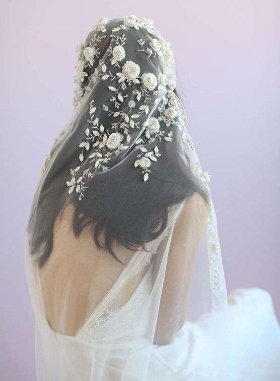 a gorgeous veil with realistic floral and leaf appliques of lace and beads for a romantic bride