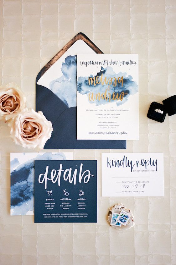 navy wedding stationery with gold and white calligraphy and glitter and watercolor touches