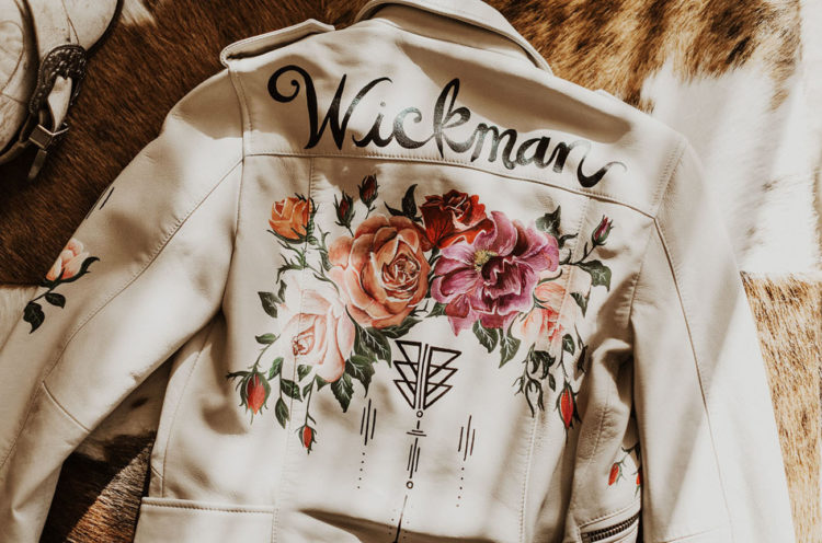 She covered up with a creamy leather jacket with hand-painted flowers