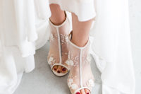 03 She was also rocking trendy sheer peep toe wedidng booties with lace floral appliques