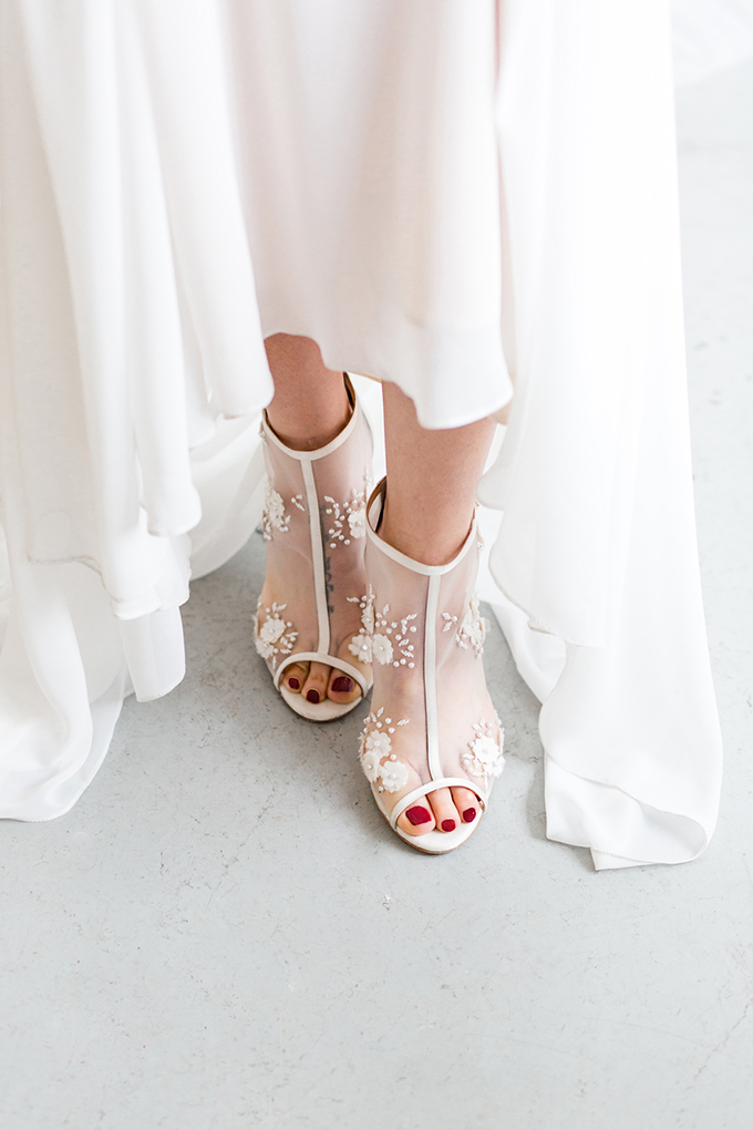 She was also rocking trendy sheer peep toe wedidng booties with lace floral appliques