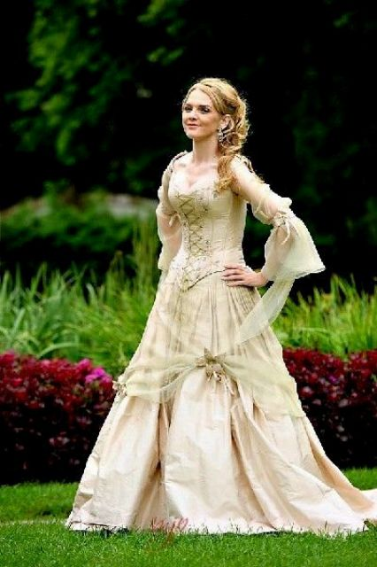 a bride rocking a medieval dress that will perfectly fit a pirate wedding, too