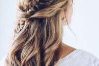 03 a chic half updo with waves, twists and a fishtail braid going down