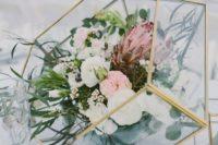 a terrarium wedding centerpiece