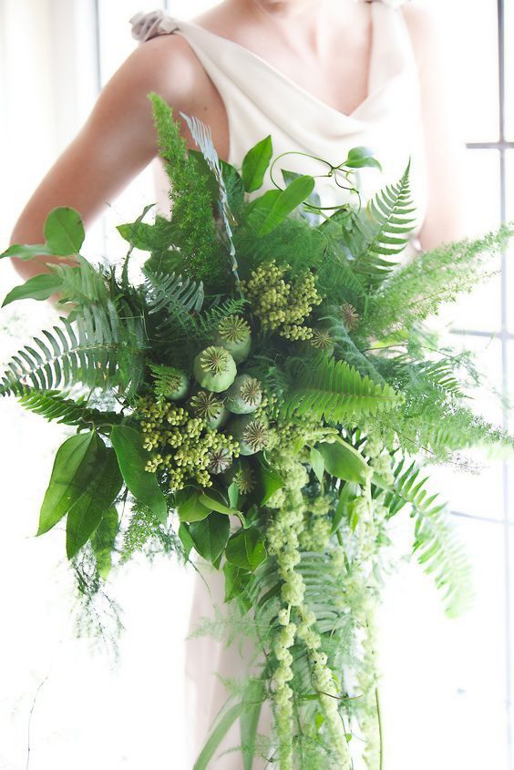 a lush cascading greenery bridal bouquet looks very textural and interesting