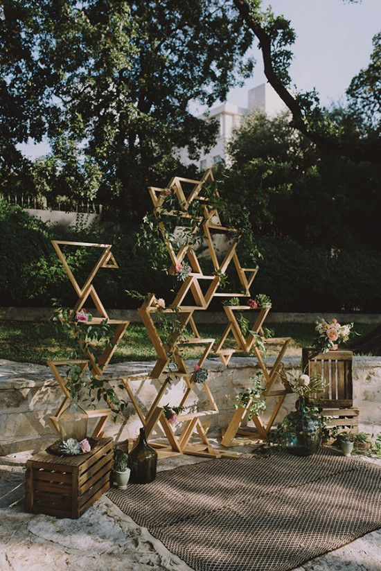 a stylish geometric wedding backdrop with greenery and blooms is ideal for many wedding styles, boho chic most of all