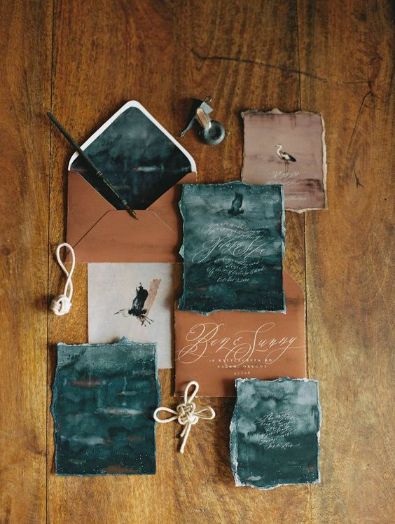moody watercolor wedding stationery in teal shades and with rust-colored envelopes