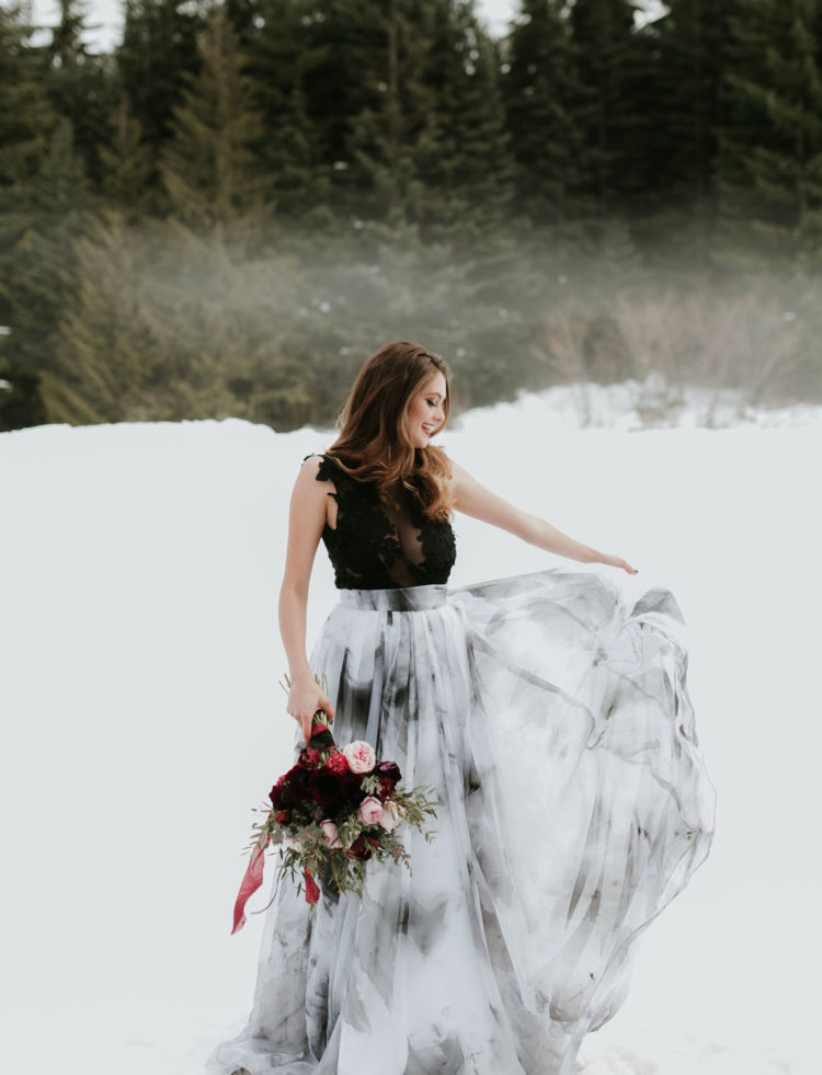 The bride was wearing a watercolor grey and white skirt and a gorgeous black lace bodysuit