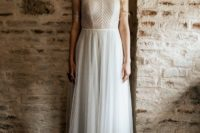 04 The bride was wearing a whimsy gown with a high neckline and cap sleeves