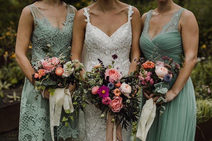 The bridesmaids were wearing mismatching green dresses with various detailing