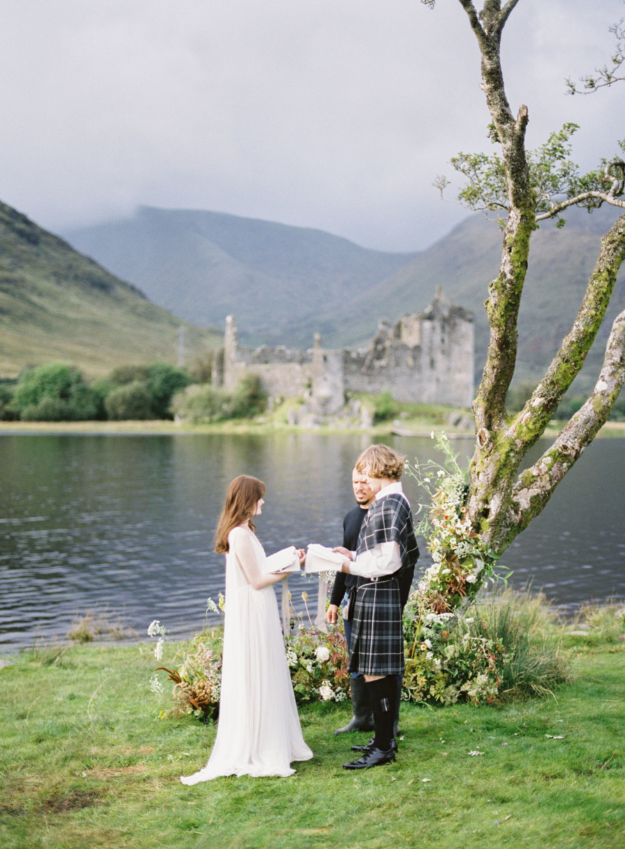 The ceremony took place at a nearby tree, which was styled with moody florals for the shoot