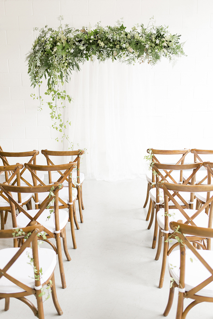The wedding arch was done in seasonal greenery and some neutral blooms