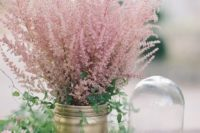 04 a gold mason jar with greenery and pink blooming branches