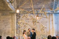 04 a stylish 3D triangle geometric backdrop with some lights for a statement look