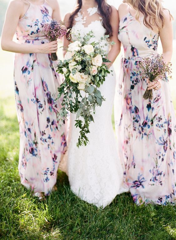mismatched blush and purple watercolor floral bridesmaids' dresses look very spring like