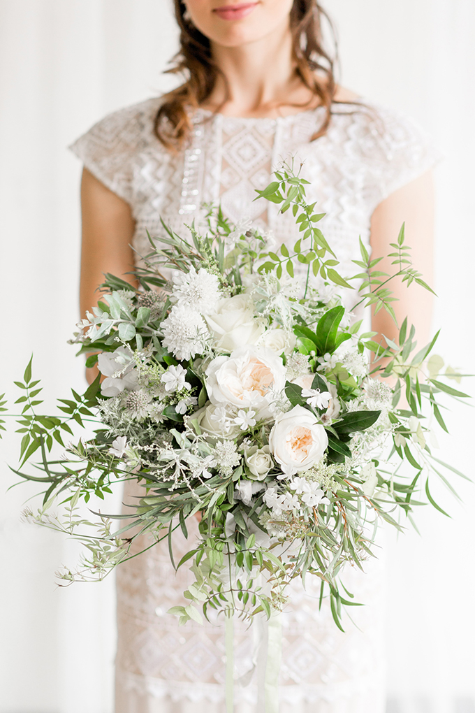 The bride's oversized textural bouquet perfectly matched the wedding arch