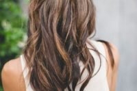 05 a fishtail braided half updo with waves and an eye-catchy geometric hairpiece that adds a boho feel