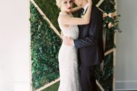 05 an edgy goemetric backdrop with lush live greenery and moss is ideal for a modern or minimalist wedding