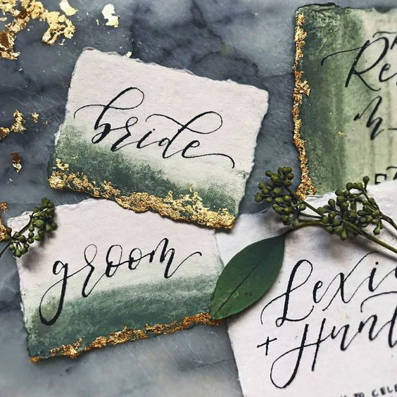 dark green watercolor wedding cards with gold glitter and calligraphy
