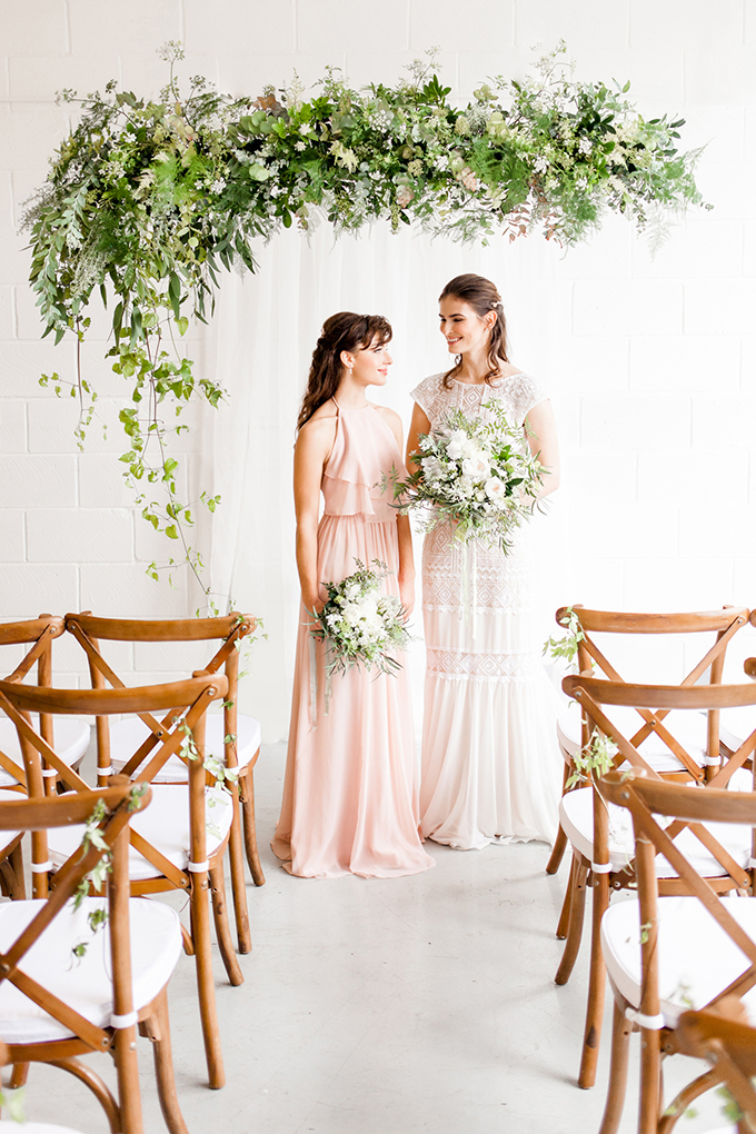 The bridesmaid was wearing a blush maxi dress with ruffles and a halter neckline