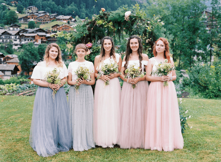 The bridesmaids were wearing pastel-colored tulle skirts and various white tops