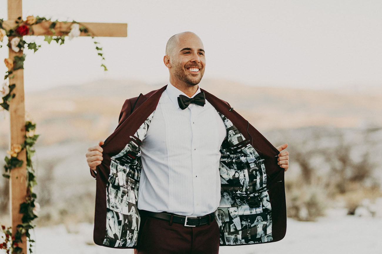 The groom was wearing a burgundy suit with photo lining, which is very cute