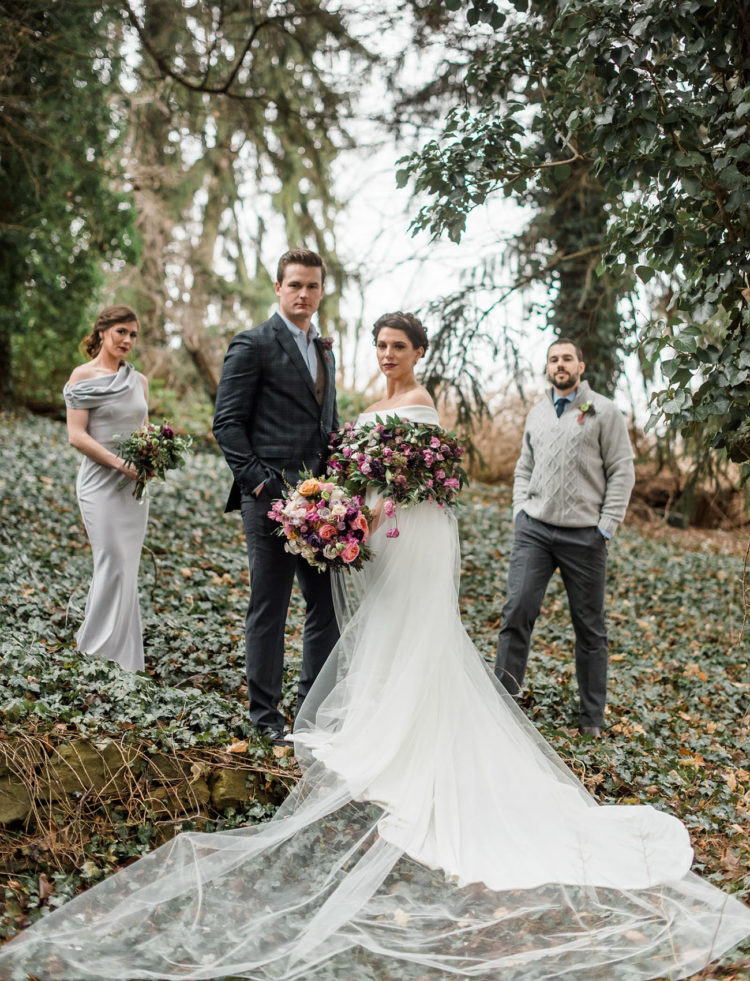 The groom was wearing a printed suit, a blue shirt, a woolen vest and a boutonniere
