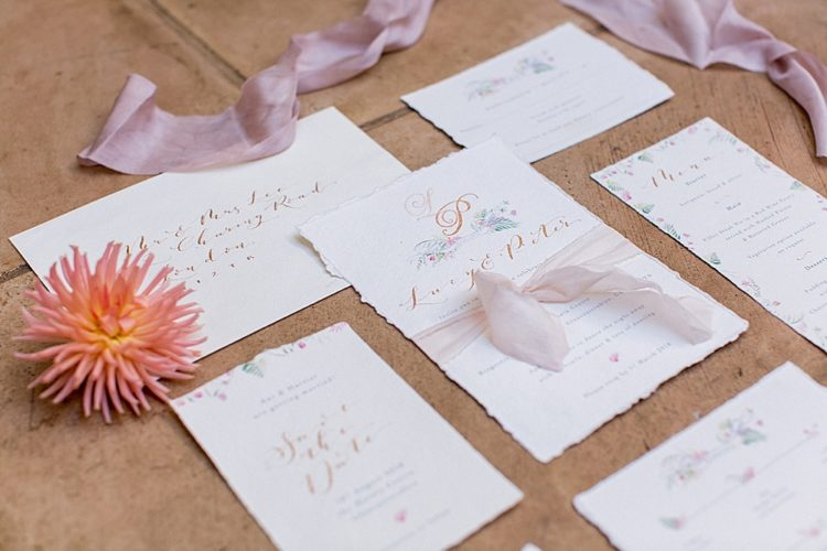 The invitation suite was done with a rough edge, with peacock feathers and botanicals