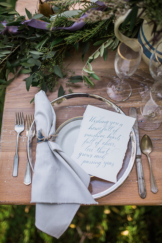 The tablescape also blended old and new - vintage flatware, modern chargers and a lush centerpiece