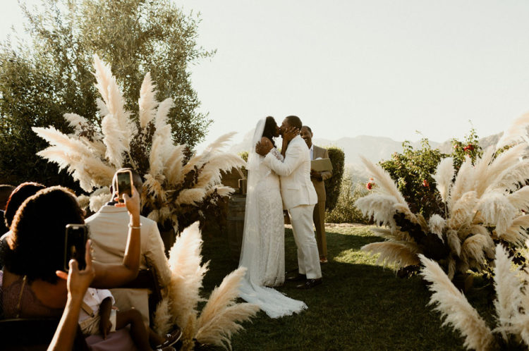 The wedding ceremony space was done with lush pampas grass touches