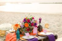 06 a colorful boho picnic setting with bold florals, linens and gold Moroccan ottomans