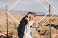 06 a gorgeous statement geometric backdrop of double squares for a desert wedding