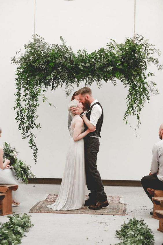 a hanging lush greenery decoration as a wedding backdrop - what can be cooler
