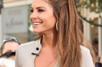 06 a layered half updo with a large one side braid and hair down is a non-typical option