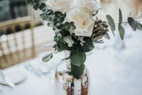 06 a mercury glass vase with white roses and eucalyptus is a chic and elegant idea
