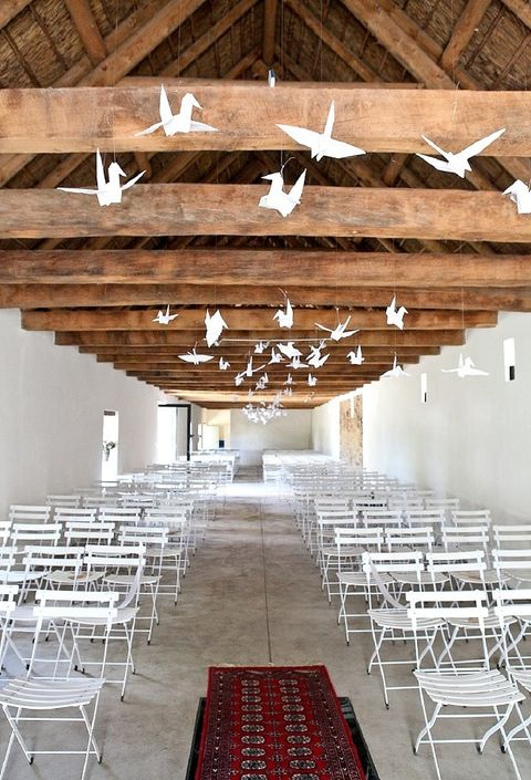 hang some large white paper cranes above the wedding ceremony space for a cool airy feel