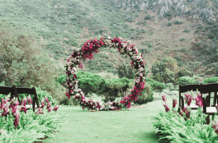 An oversized circle floral arch in jewel tones looked just wow and besides it's a hot trend