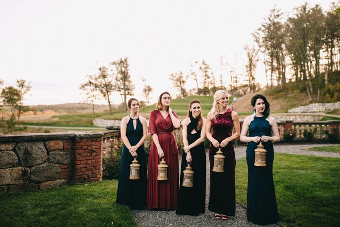 The bridesmaids were wearing mismatched gowns in dark jewel tones