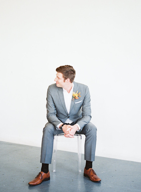 The groom was wearing a grey suit, a white shirt, cognac shoes and a fall boutonniere