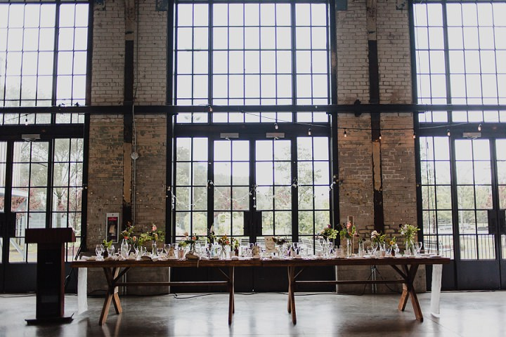 The venue was industrial, filled with natural light and decorated with florals