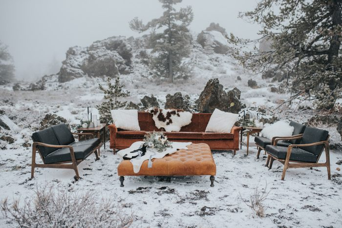 The wedding lounge was right in the snowy mountains, with leather furniture and faux animal skins